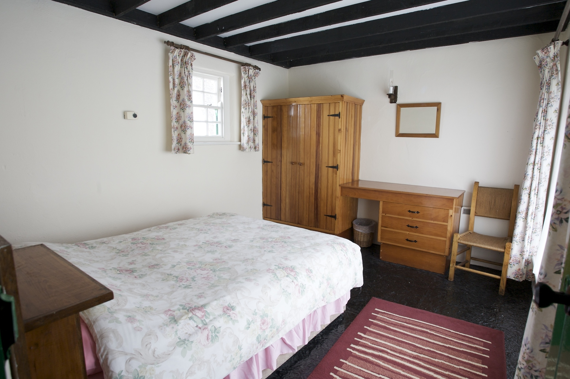 Corofin Bedroom with traditional ceiling beams