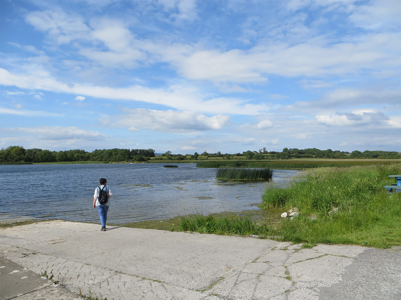 Lake Inchiquinn Corofin with person standing on the slipway
